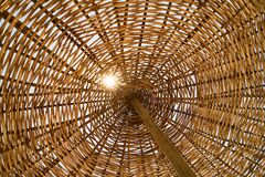 Wicker umbrella abstraction Stock Images