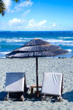 Wicker umbrella on the beach Royalty Free Stock Images