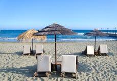 Wicker umbrellas on the beach Stock Photos