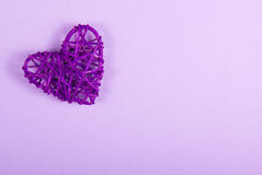 Wicker Valentine on a purple background. St. Valentine`s Day. Stock Photography