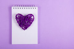 Wicker Valentine and white notes on a purple background. Handmade. Valentine`s Day. Copy space Royalty Free Stock Image