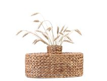 Wicker vase with wheat ears. Stock Photos