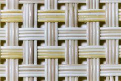 Wicker weaving and wicker pattern. Pliable twigs, typically of willow, plaited or woven to make items such as furniture and baskets royalty free stock photography