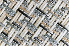 Wicker weaving and wicker pattern. Pliable twigs, typically of willow, plaited or woven to make items such as furniture and baskets royalty free stock image