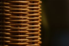 Wicker wood furniture closeup. Brown handicraft weave Royalty Free Stock Photography