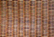 Wicker wooden background. Rattan woven top view closeup. Rattan chair interlace of natural material. Ecologic craft. Golden basketry furniture. Asian handcraft Royalty Free Stock Images