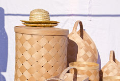 Wicker wooden baskets and hats sold at market fair Royalty Free Stock Photos