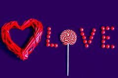 Wicker wooden heart and candy, royalty free stock photo