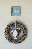 Wicker wreath with white wooden fish Royalty Free Stock Photos