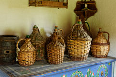 Wickerwork Demijohns on Display Stock Images