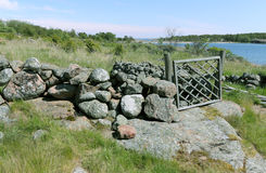 Wicket en la cerca de piedra Imágenes de archivo libres de regalías