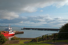 Wicklow Ireland North Harbor Commercial Dock with seawall jetty and Lighthouse in the background Stock Photography