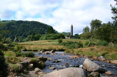 Wicklow landscape. Scenic view of stream in County Wicklow landscape with church building in background, Ireland Royalty Free Stock Images