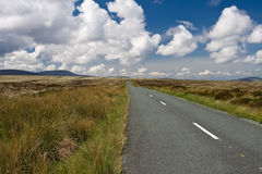 Wicklow Mountains. Road cutting across picturesque valley of Wicklow Mountains in Ireland stock photo