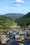 Wicklow Mountains and waterfall. Wicklow Mountains view in Ireland on Glendalough Village Royalty Free Stock Image
