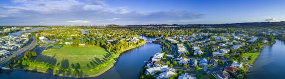 Wide aerial panorama of Reedy creek and luxury houses. Varsity Lakes, Gold Coast, Queensland, Australia royalty free stock photo