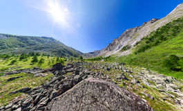 Wide aerial panorama river stone and mountain peaks Royalty Free Stock Photography
