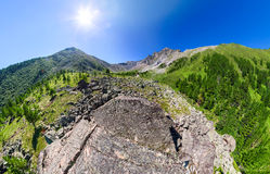 Wide aerial panorama river stone and mountain peaks Stock Image