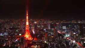 Wide aerial time-lapse shot of Tokyo Tower at night, Japan. stock video footage