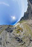 Wide-angle aerial panorama A man stands on top in the mountains Stock Photo