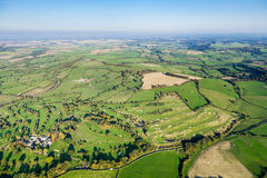 Wide Angle, Aerial View of British Countryside. Aerial view of beautiful green countryside in Somerset, UK. Includes rolling fields, farms, trees and a golf stock photo
