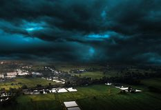 Agriculture farm and storm cloud stock images