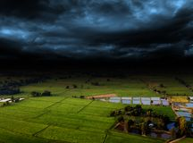 Agriculture farm and storm cloud royalty free stock images