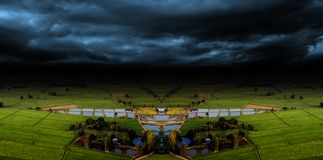 Agriculture farm and storm cloud royalty free stock image