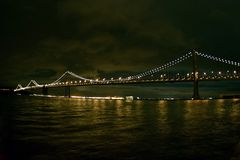 Wide angle Bay Bridge at night. A wide-angle perspective of the Bay Bridge at night royalty free stock image