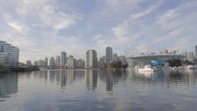 Wide angle - BC place and false creek condos. VANCOUVER,CANADA - CIRCA December 2014 :wide angle - BC place and false creek condos stock video