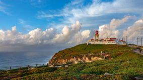 Wide angle of Cabo da Roca Lighthouse timelapse, the end of Europe. Wide angle time-lapse view of Cabo da Roca over the cliffs at dusk, Portugal. The most stock footage
