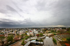 Wide angle cityscape before storm. Wide angle view of Cloudy sky above city during the rains Stock Photos