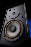 Wide angle close up of an audio loudspeaker. With an electric blue glow stock images