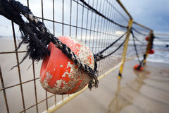 Winter Beach Buoy and Fence Royalty Free Stock Image