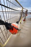 Winter Beach Buoy and Fence Stock Images