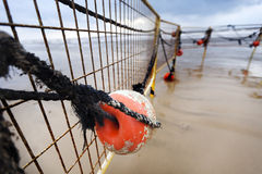 Winter Beach Buoy and Fence Stock Image