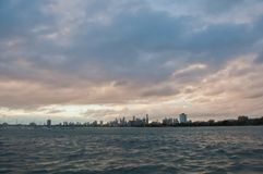 Wide angle evening scene of skyscrapers horizon with ocean and tall office and residential towers in Melbourne Australia stock images