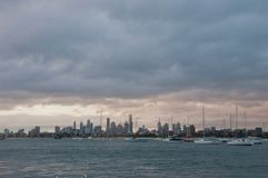 Wide angle evening scene of skyscrapers horizon with ocean and tall office and residential towers in Melbourne Australia royalty free stock photos
