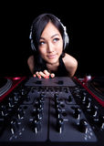 Wide angle female DJ on the decks. Wide angle shot of a female DJ using the fader Stock Photo