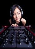 Wide angle female DJ on the decks Stock Photo