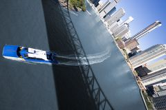Wide angle of ferry passing under bridge Stock Photos