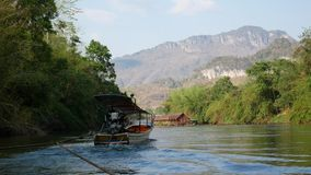 Wide angle footage of boating and rafting trip along River Kwai stock video footage