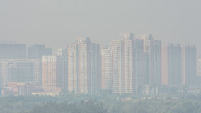 Wide angle horizontal shot of buildings in beijing on a foggy Royalty Free Stock Photos
