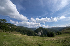 Wide angle landscape. Green and blue landscape in the mountains Stock Images