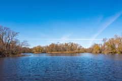 Wide angle landscape of an island in the vast St. Croix River with Wisconsin on the left shoreline and Minnesota on the right shor. Eline - sunny day with stock image