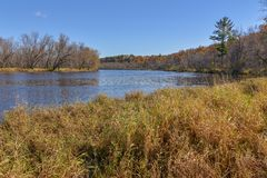 Wide angle landscape of the vast St. Croix River separating Wisconsin and Minnesota - sunny day with beautiful blue skies stock photo