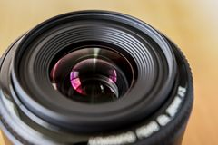 Wide-angle lens. A bright photo of the lens. 35 mm stock images