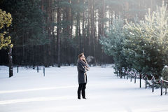 Wide angle man in winter forest Stock Photos