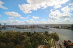 Wide angle overview at 100 metres height over the Rotterdam Skyline with blue sky and white rain clouds. Seen from the Euromast Royalty Free Stock Photography