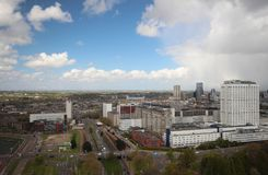 Wide angle overview at 100 metres height over the Rotterdam Skyline with blue sky and white rain clouds. Seen from the Euromast Royalty Free Stock Photo